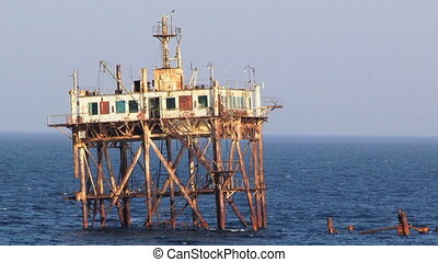 Tower in the sea - Most old central tower rescuers standing...