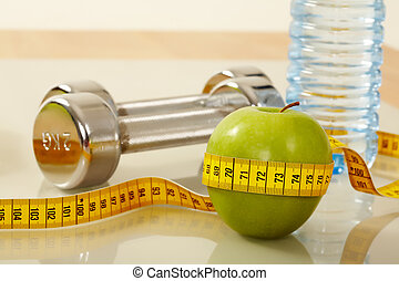 Objects for training - Closeup of green apple with measuring...