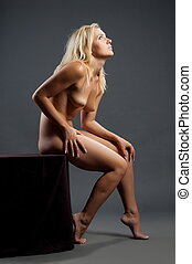 Beautiful girl - Beautiful sexual girl blonde pose on gray...