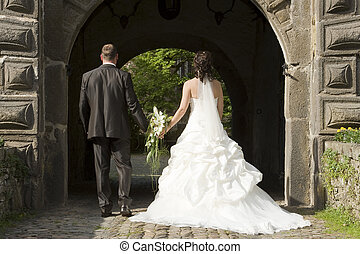 wedding - beautiful bride and groom at the way back from the...