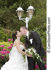 wedding - beautiful bride and groom in the park