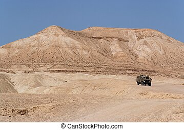 Israeli army Humvee on patrol in the Judean desert