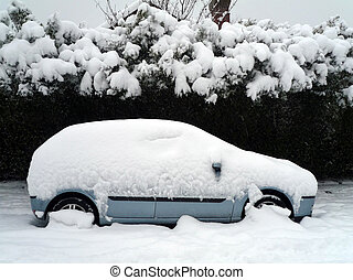 A car under the snow - A car stuck in the snow in winter