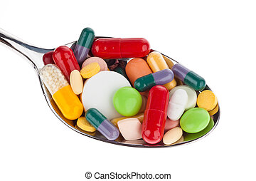 Tablets and medicines on spoon - Many different colored...