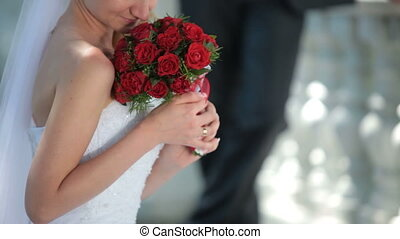 red wedding bouquet - the bride with a wedding bouquet of...