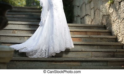 Wedding Dress - a bride in a wedding dress stands on the...