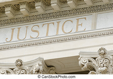 justice word engraved on the pediment of the courthouse