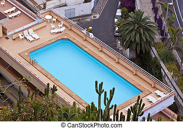 Rooftop pool - Swimming pool on top of a resort