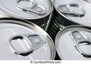Canned food - detail of the lids of four cans of conserved...