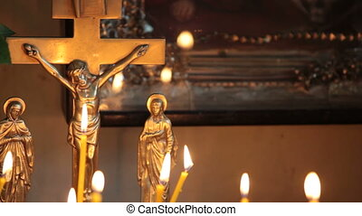 Crucifix and burning candles