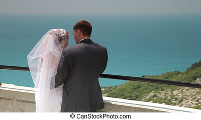 bride and groom on the terrace in Foros, Crimea, Ukraine