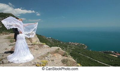 bride and groom on a cliff