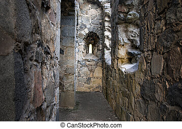 Ancient ruin - Interior of ancient stone ruin with window