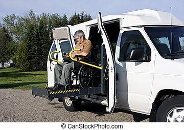 handicap wheelchair lift - man in a wheelchair uses a...