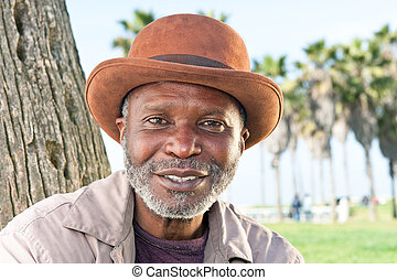 Elderly black man smiling - An elderly black man with a...
