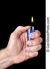 Lit butane lighter - Image of a person lighting a blue...
