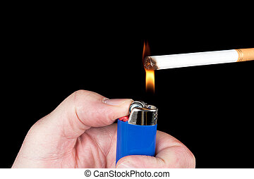 Lighting a cigarette - A person lights a cigarette with a...
