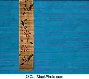 Flower bamboo banner on blue ribbed wood background