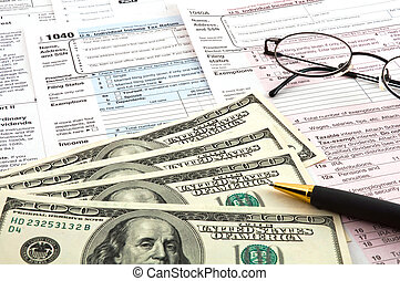 Tax time Business concept - The tax forms with the glasses,...