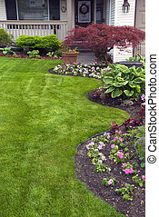Manicured Spring Garden - Spring flower bed planted and...