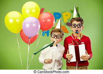 Birthday fun - Portrait of smart boys in funny eyeglasses...