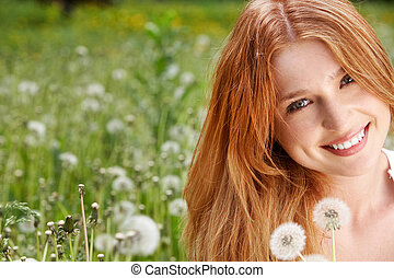 Woman and dandelions - Portrait of charming girl with...