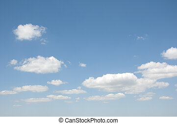 clouds in the blue sky on a sunny day