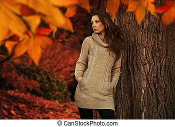 Young beauty in a autumn scenery