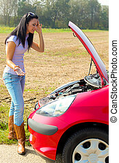 Woman has in her car breaks down. Engine failure - Young...
