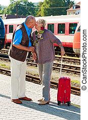 Mature aged couple at the train station - Mature vital...