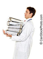 Doctor on stress with stacks of files