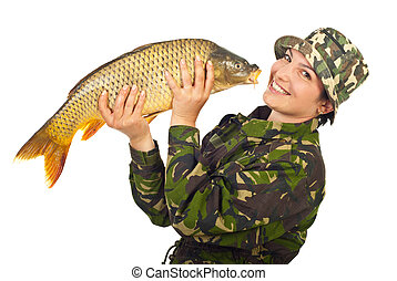 Laughing fisher woman holding big fish isolated on white...