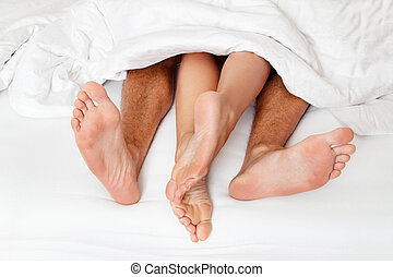 Feet of one couple in bed. - Dier a couple feet in bed....