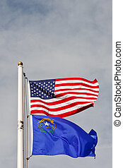 American and Nevada flags on Pole Under Sky - An American...
