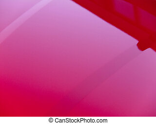 Red car hood detail - Abstract close up of a red automobile...