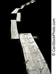 Wooden foot path with black background