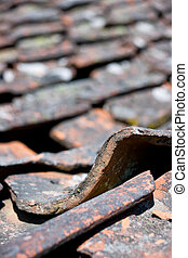 Old tiled roof - Close up of very old tiled roof