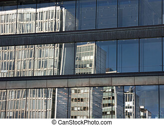 Reflected office buildings - Office buildings reflected in a...