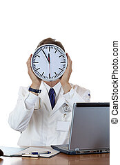 Stressed medical holds clock in front of face because of time pressure