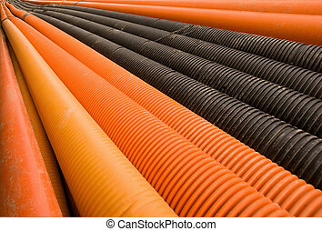 Plastic pipes - Orange and black plastic pipes