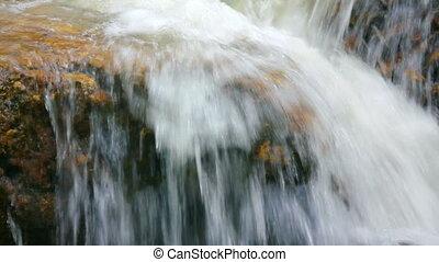 waterfall among rocks close-up