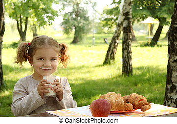 young girl drink milk