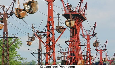 industrial cableway and moving trolleys with rock -...