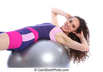 Beautiful happy woman doing fitness ball exercises -...