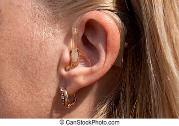 digital hearing aids on young woman ear