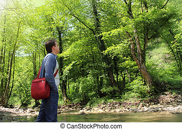 Relaxing man in sunny summer forest - Man enjoying the fresh...