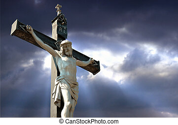 Crucifixion - A statue of Jesus Christ crucified against...