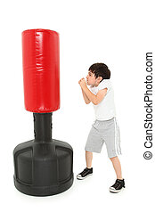 Adorable Boxing Boy - Adorable 8 year old boy practicing...