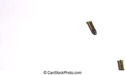 Bullets dropping on white background