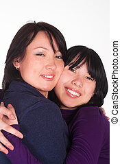 two pretty girls together on a white background